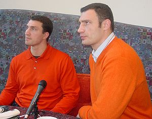 Vitali Klitschko - Brothers Wladimir (left) and Vitali (right) Klitschko sporting the colors of the Orange Revolution