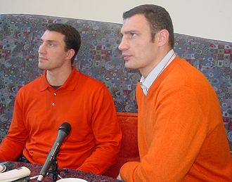 Vitali Klitschko - Brothers Wladimir (left) and Vitali (right) Klitschko supporting the colors of the Orange Revolution