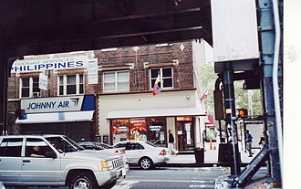 Filipinos in the New York metropolitan area - Krystal's Cafe and Johnny Air Cargo shops on Roosevelt Avenue, Woodside, Queens, New York City.