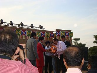 Selja Kumari - Kumari Selja Presenting Certificate of Commendation to Dr. G. Dewan on First Chandigarh Crafts Mela