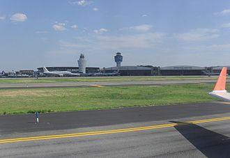 LaGuardia Airport - LaGuardia Airport as seen from a taxiway in 2010. Note both the new and old control towers.