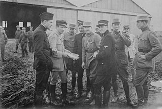 Lafayette Escadrille -  Kiffin Rockwell, Capt. Georges Thenault, Norman Prince, Lt. Alfred de Laage de Meux, Elliot Cowdin, Bert Hall, James McConnell and Victor Chapman (left to right)