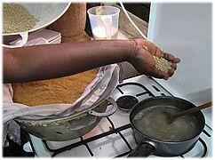 Lakh - araw millet porridge 1. boil.jpg