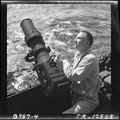 Lt.Cdr. C.F. Jacobs, formerly a leading magazine illustrative photographer, with his F-16 camera aboard the USS Iowa... - NARA - 520843.tif