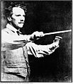 Luigi Von Kunits with conducting baton.jpg