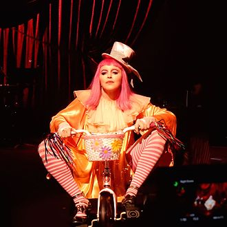 Madonna: Tears of a Clown - Madonna began the show by entering the stage on a tricycle and dressed as a clown.