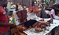 Man at Work in Africa - Man Selling Roasted Meat Popular Called Suya in Africa.jpg