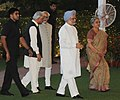 Manmohan Singh and his wife Smt. Gursharan Kaur with the Vice President, Shri Mohd. Hamid Ansari and the Minister of State for Planning, Science & Technology and Earth Sciences, Dr. Ashwani Kumar, at an Iftar party.jpg