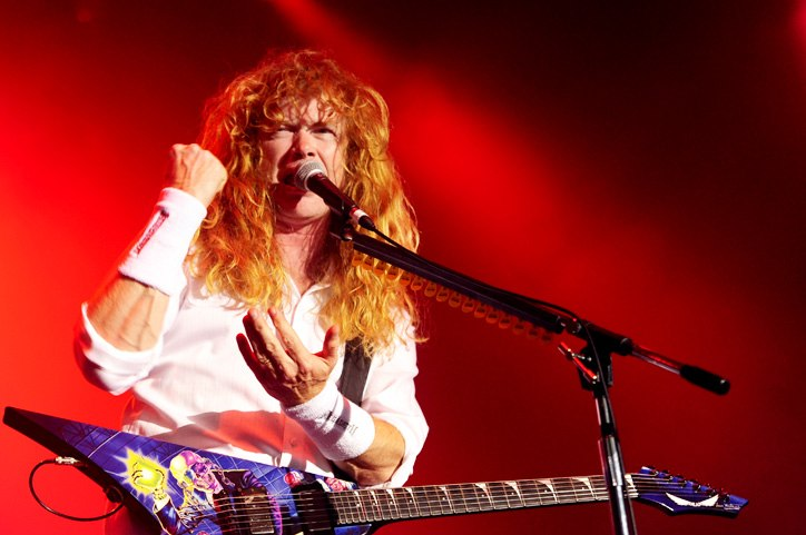 Photo of a long-haired man with an angular electric guitar