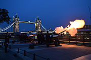 Members of the Honourable Artillery Company firing their guns at the Tower of London