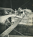 Men loading rotan on ship, Indonesia Tanah Airku, p23.jpg