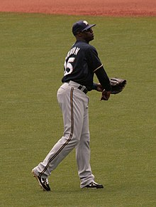 Mike Cameron in a San Diego Padres uniform playing catch in the outfield