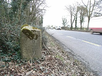 Irish measure - Milestone on the N2 road reading: Slane 5, Carrickmacross 21 and Collon 9 (Irish) miles. In modern statute miles this would be 6⅓, 30¾ and 11½ miles respectively.