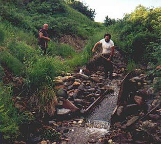 Sluice - Miners working a small sluice on Lucky Gulch, Alaska