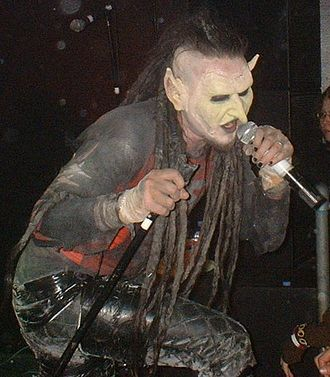 "Mortiis - Mortiis performing in Leicester in 2005 wearing an ""Era III mask"""