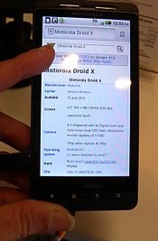 A Motorola Droid X showing an Android 2.3 home screen