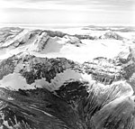 Mount Katmai, mountain glaciers seperated by arete peaks, and bergschrund in the background, August 26, 1969 (GLACIERS 7041).jpg