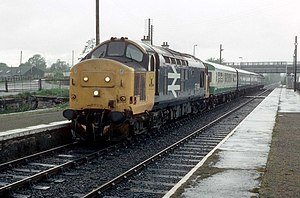 Route availability - A class 37 in British Rail large logo livery at Muir of Ord railway station, 1988 with a medium Route availability of 5.