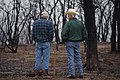 NRCS District Conservationist Tony Dean (right) discuss ranch management options with a Jack County landowner after a wildfire burned through the area three weeks earlier. (24993451632).jpg