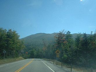 New York State Route 73 - NY 73 approaching a steep grade with a mountain of the Adirondacks in view