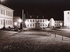 Wiesentheid in the night - view from church to vicarage, town hall, castle.