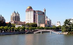 The skyline of Nantong flanking the Hao River, a historical moat.