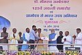 """Narendra Modi presenting the credit certificates, under various schemes to the beneficiaries from Scheduled Casts, at the launching ceremony of the """"Gram Uday se Bharat Uday"""" Abhiyan, in Mhow, Madhya Pradesh (2).jpg"""