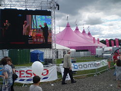 Many visitors to the National Eisteddfod never go into the Pavillion (background), being able to view the competitions on the big screen (foreground). (Mold, 2007)
