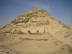 Great but ruined pyramid made of bricks and stones in the desert.