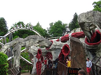 Nemesis (roller coaster) - Some of Nemesis' theming with the ride's first corkscrew in the background