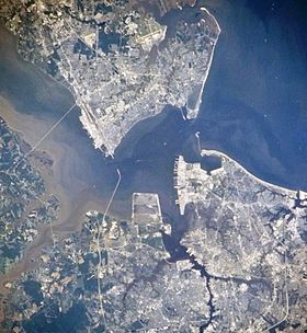 Satellite View of Hampton Roads with the Hampton Roads channel at center. (City urban centers visible, clockwise from top: Newport News, Hampton, Norfolk, Portsmouth)