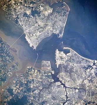 Newport News, Virginia - Newport News, Hampton, Portsmouth and Norfolk, Virginia from space, July 1996 (Newport News is seen in the upper left quadrant)