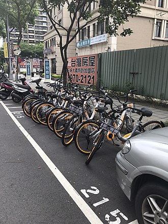 OBike - oBikes parked in automobile parking spots