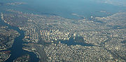 Aerial view looking west over downtown Oakland, Lake Merritt and the Port of Oakland.