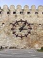 Old fortress wall with a clock, Baku, Azerbaijan.jpg