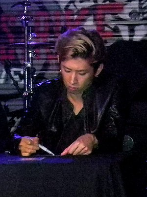 Takahiro Moriuchi - Taka during an autograph session at Lucky Strike Live, October 22, 2015