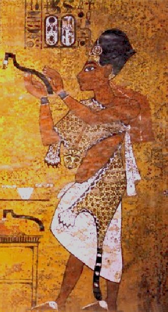 Ay - Pharaoh Ay performing the Opening of the Mouth ceremony on Tutankamun. Ay is wearing the Leopard skin worn by Egyptian High Priests and a Khepresh, a blue crown worn by Pharaohs.