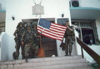 United States invasion of Panama - U.S. soldiers holding a U.S. flag at La Comandancia