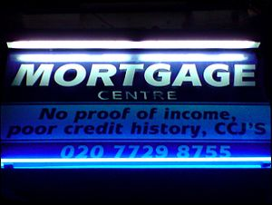 English: Sign of a mortgage centre in East Lon...