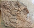 Pagoda tile of demon wrestling a serpent.jpg