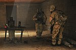 Paratroopers participate in gas chamber training 130530-A-UU237-143.jpg