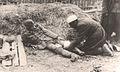 Partizanski bolničar previja ranjenog Nemca na Sremskom frontu.jpg
