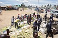 People are selling maize corn in the street market.jpg