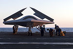 Personnel load a U.S. Navy X-47B Unmanned Combat Air System demonstrator aircraft on an aircraft elevator aboard the aircraft carrier USS George H.W. Bush (CVN 77) May 14, 2013, in the Atlantic Ocean 130514-N-FE409-027.jpg