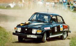 A Saab 96 V4 participating in a historic rally.