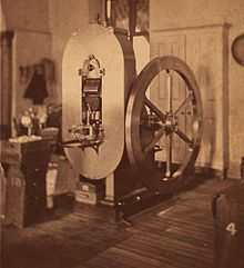 A photograph of a large machine used to strike coins