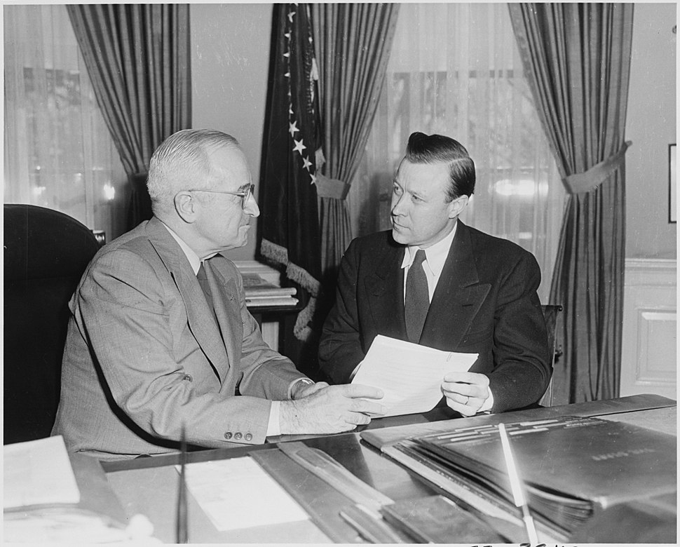 Photograph of President Truman in the Oval Office, conferring with labor leader Walter Reuther, president of the... - NARA - 200406
