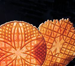 Pizzelle showing different designs on front and back