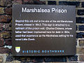 Plaque on the remaining wall of the Marshalsea prison, London, December 2007.jpg
