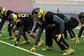 Players prep their positions 150101-A-GX635-803.jpg